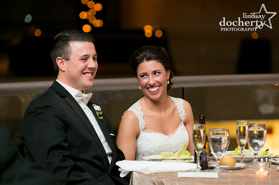 bride-and-groom-reaactions-to-toasts-at-National-Constitution-Center-wedding-in-Philadelphia