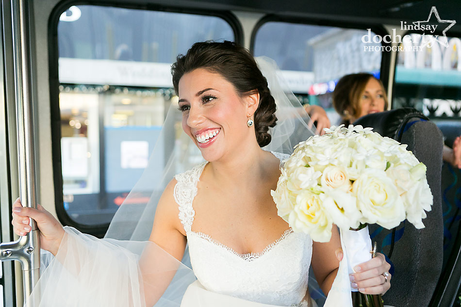 bride-smiling-on-trolley-to-wedding