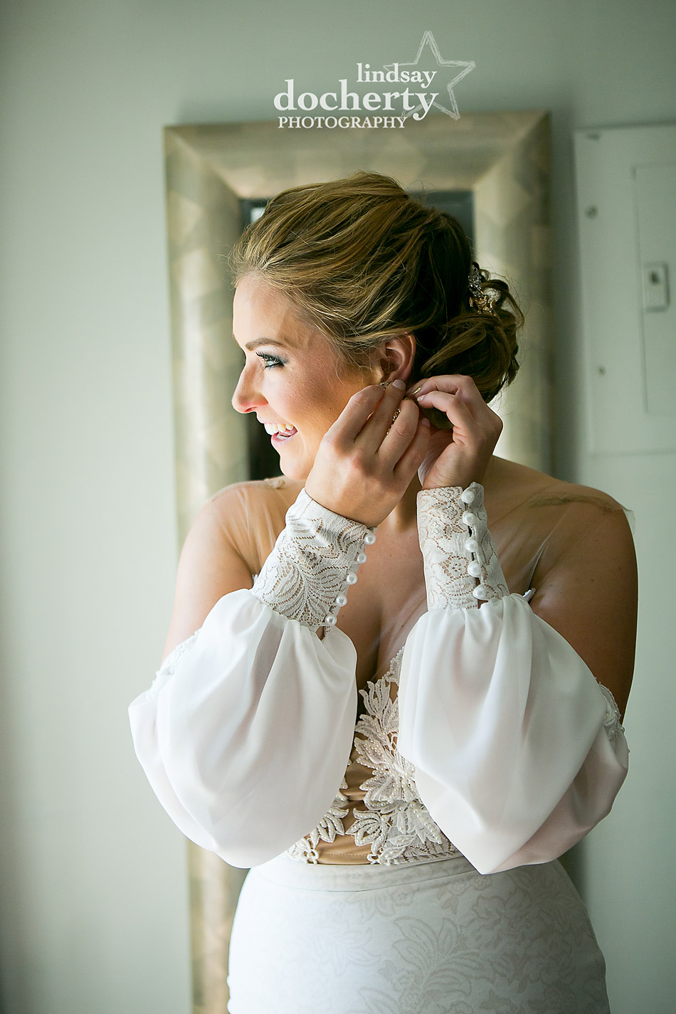 Philadelphia wedding photographer at Morris House Hotel bride putting on earrings while getting ready