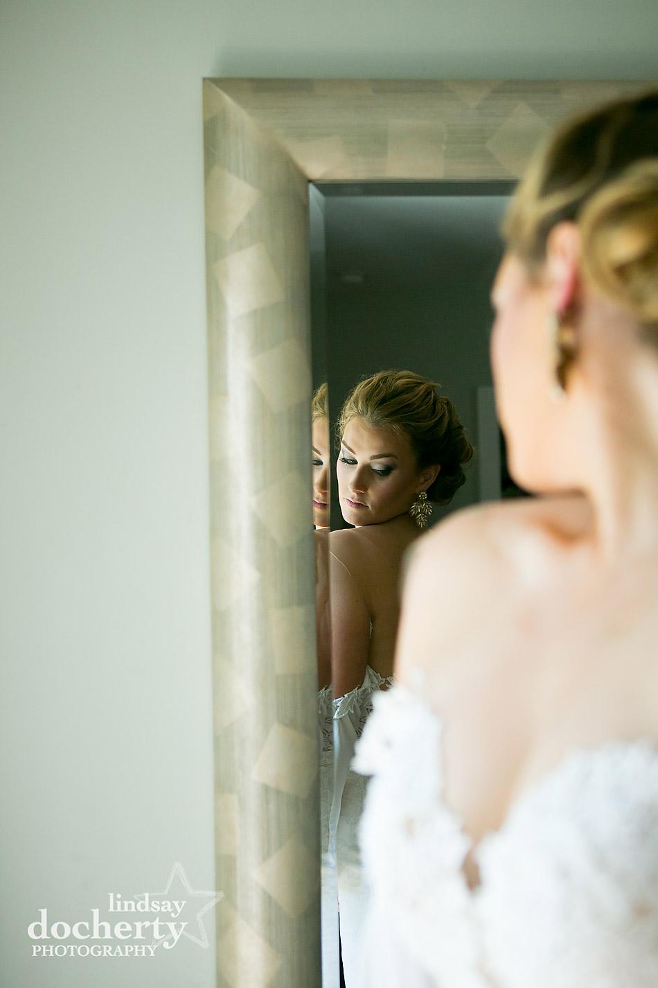 bride looking in mirror at dress Philadelphia wedding photographer at Morris House Hotel
