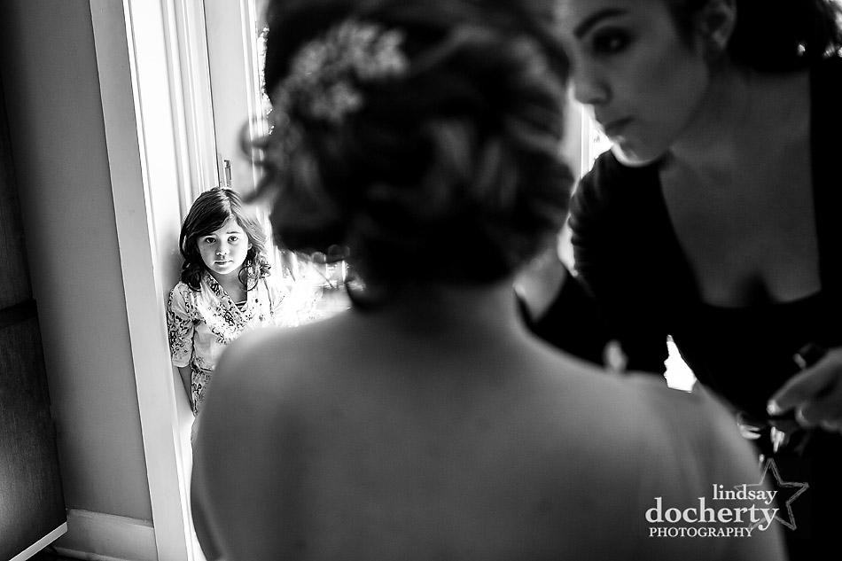 Philadelphia wedding photography at Morris House Hotel flower girl watching bride getting makeup