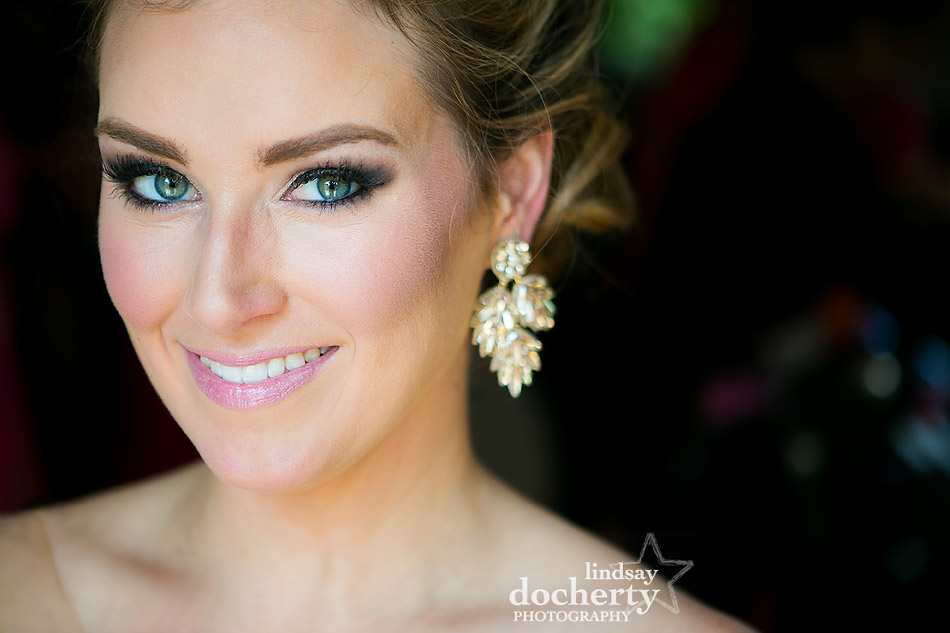 Philadelphia wedding photographer at Morris House Hotel bride with green eyes and statement earrings