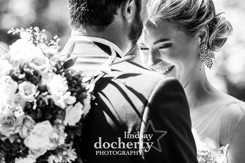 Philadelphia wedding photographer at Morris House Hotel bride and groom laughing together