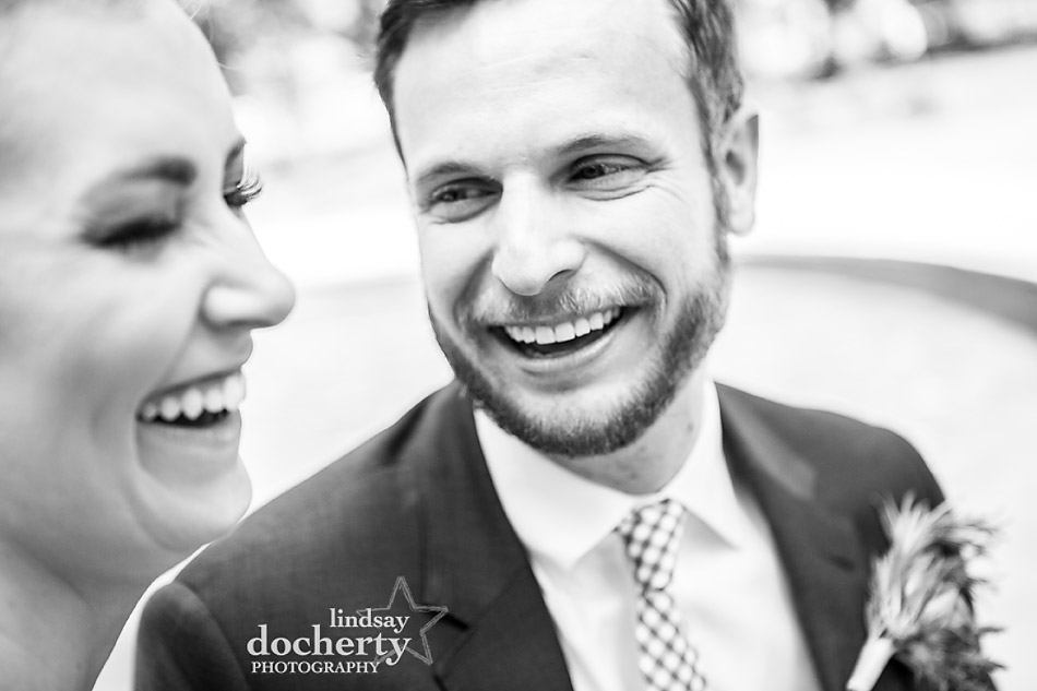 candid Philadelphia wedding photographer at Morris House Hotel laughing bride and groom