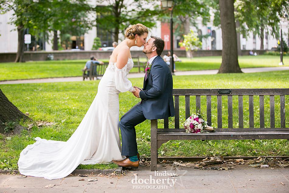 Philadelphia wedding photographer at Morris House Hotel bride kissing groom in Washington Square Park