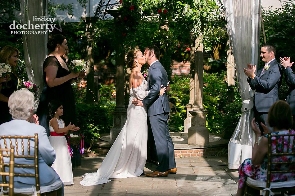 kiss at the altar ceremony Philadelphia wedding photographer at Morris House Hotel