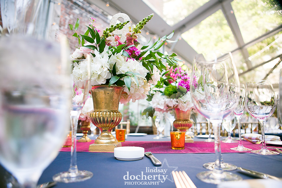 magenta and navy linens at wedding reception with gold accents Philadelphia wedding photographer at Morris House Hotel