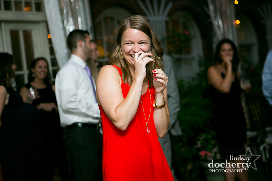 candid Philadelphia wedding photographer at Morris House Hotel laughing guest