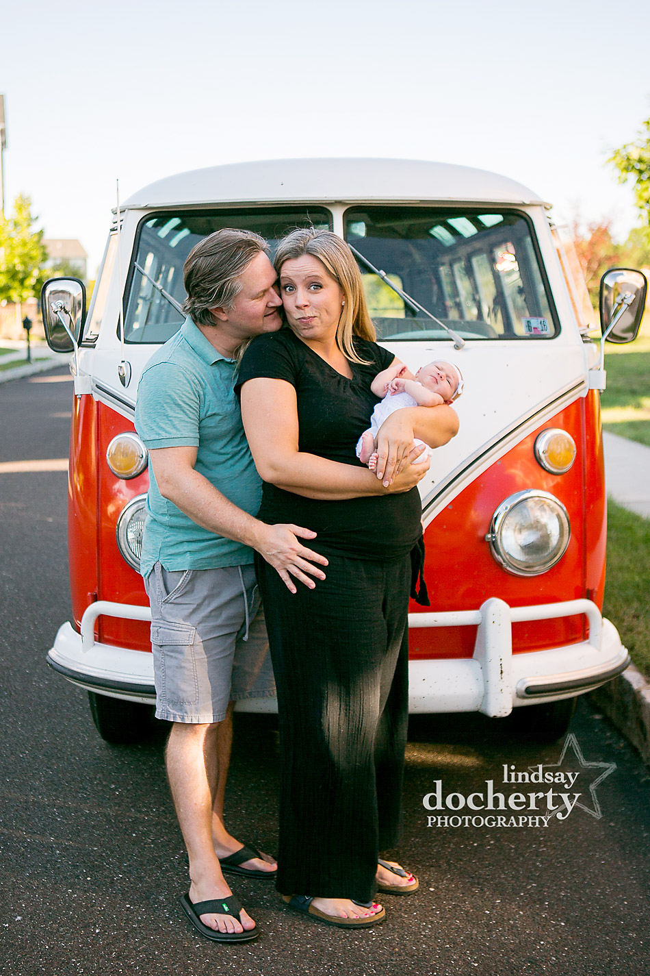 newborn baby photo session with vintage red VW bus
