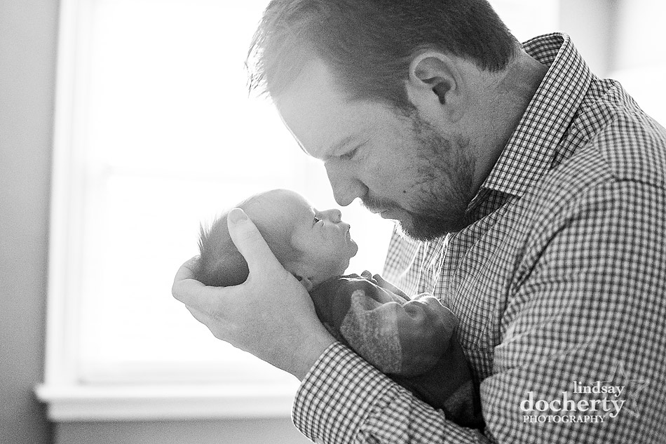 baby and dad nose to nose picture in nursery in Philadelphia