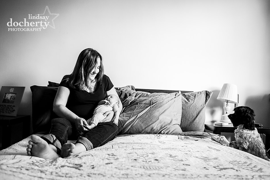 mom and baby photography on bed with dog