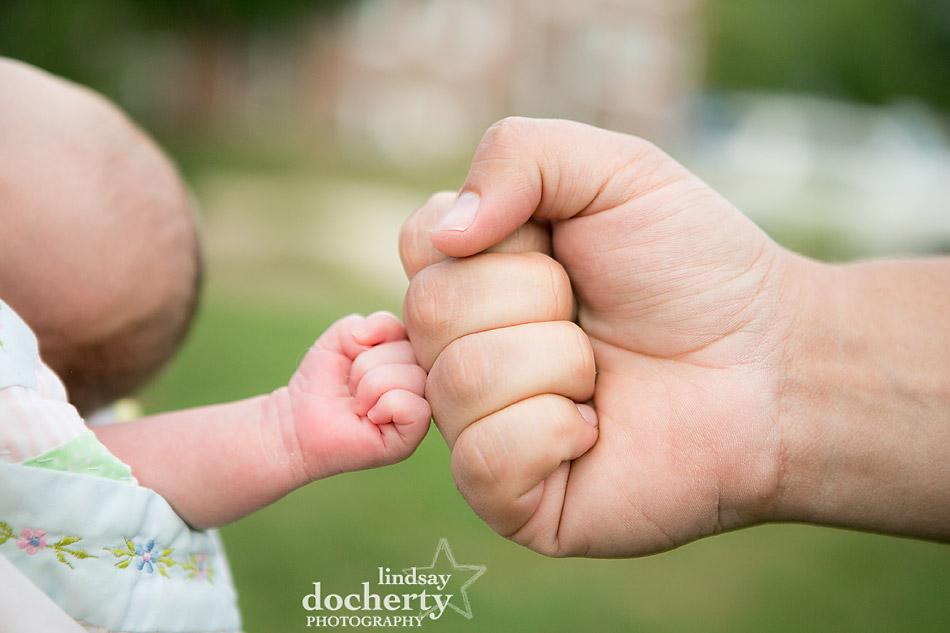 cute newborn baby fist bump picture