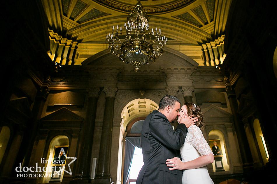 Philadelphia city hall bride and groom in ornate room