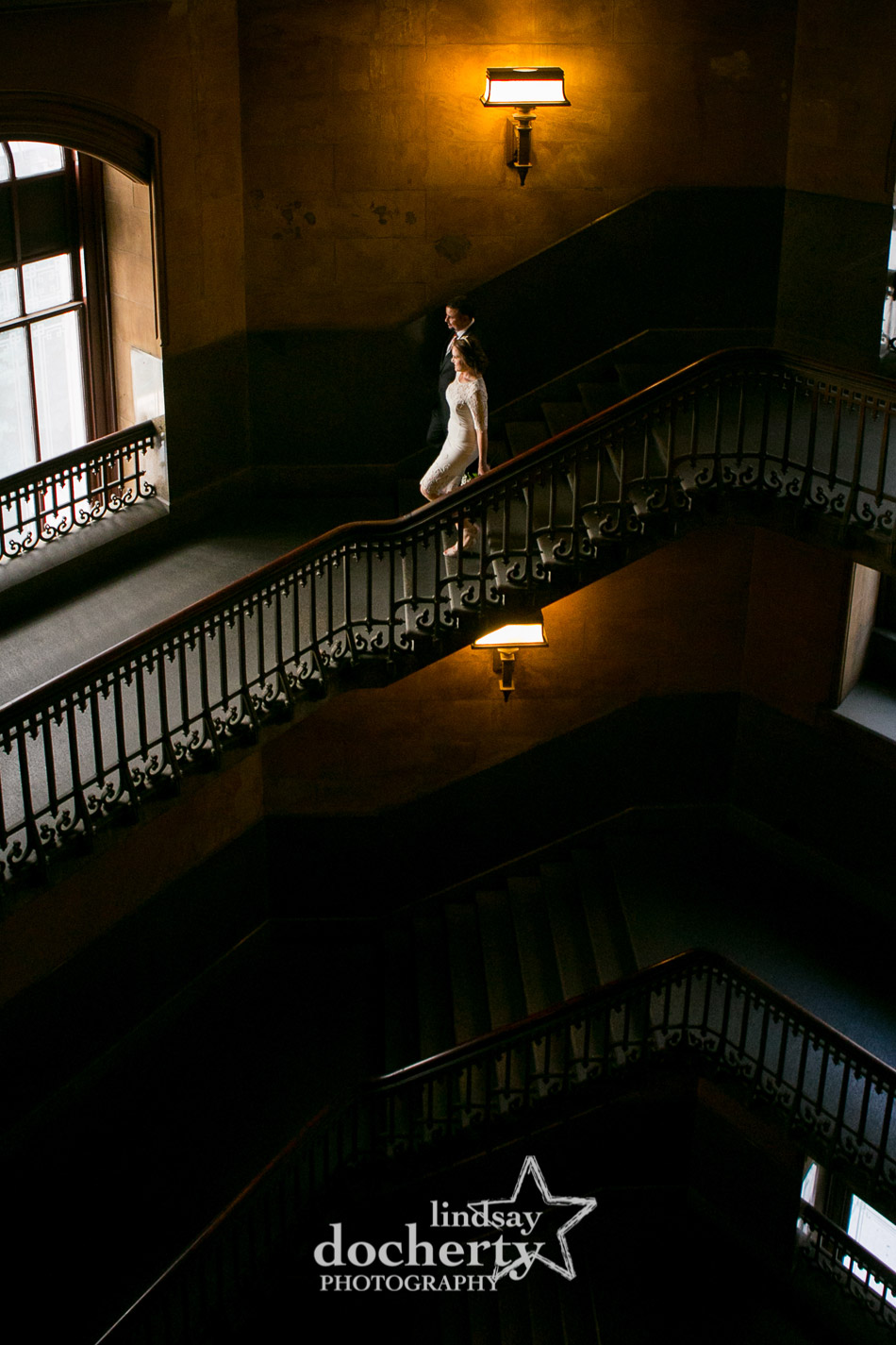 Wedding couple walking down stairs in Philly City Hall before wedding