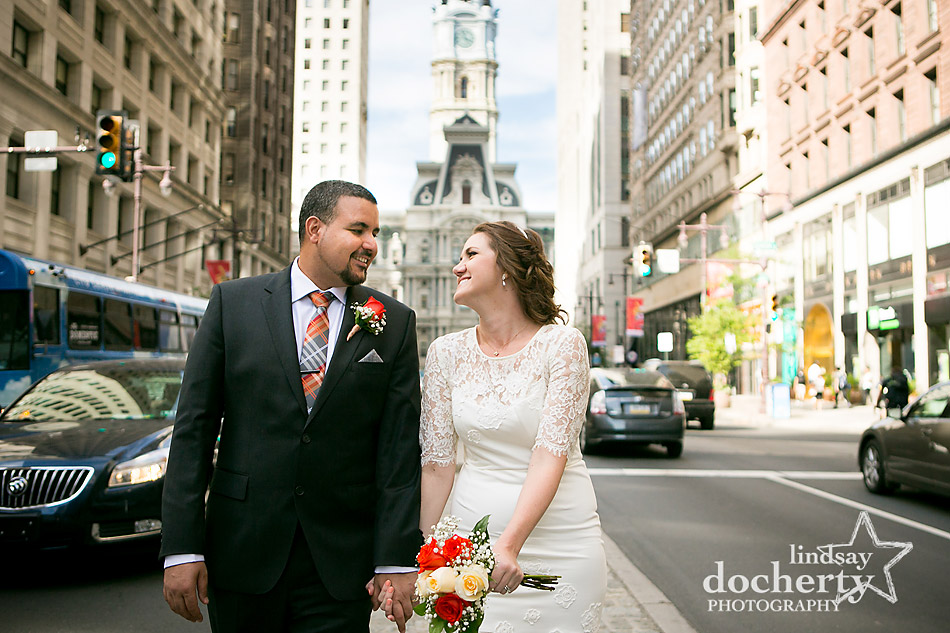 bride and groom on Broad Street in front of Philadelphia City Hall on wedding day