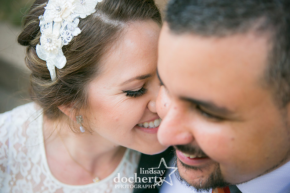 closeup of bride with headband kissing groom