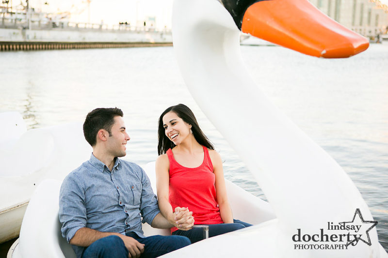 Swan boat ride at Spruce Street Harbor Park engagement session in Philadelphia