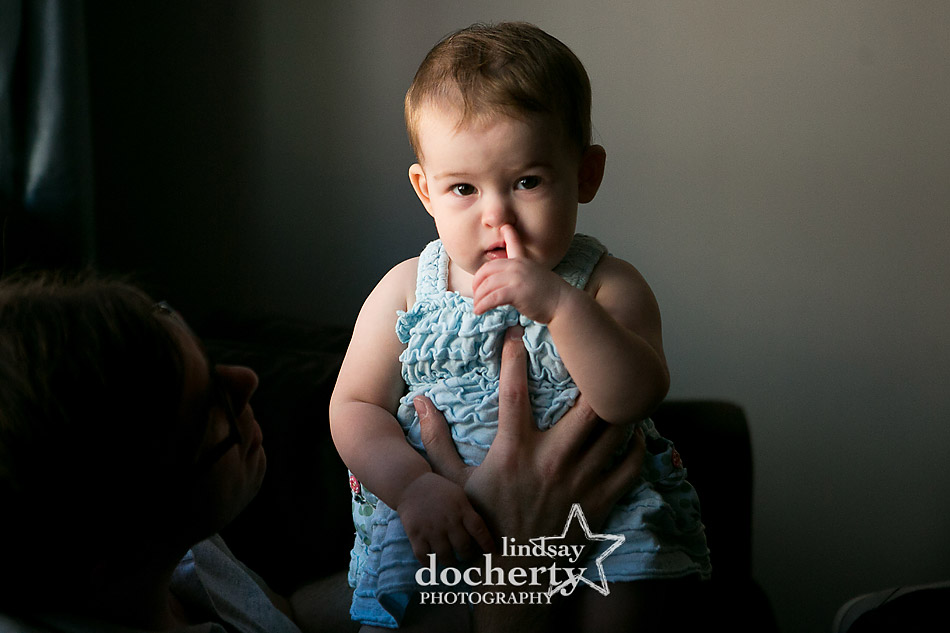 baby girl picture picking nose