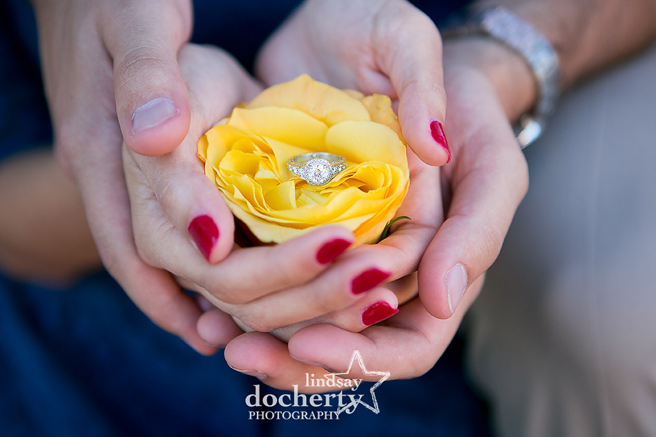 diamond-engagement-ring-in-yellow-rose-with-hands