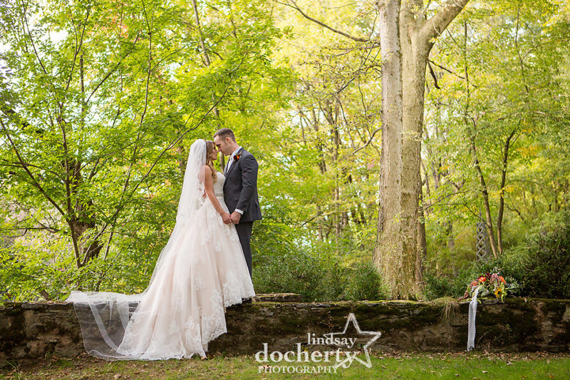 Fall outdoor Riverdale Manor wedding with bride in pink gown and cathedral veil