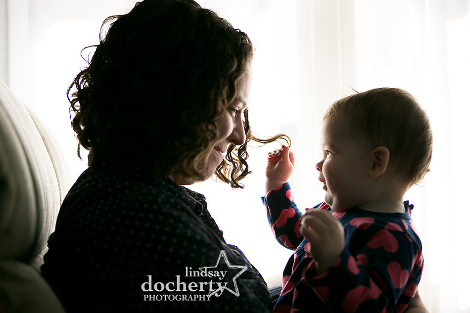 mommy and daughter playing with curly hair