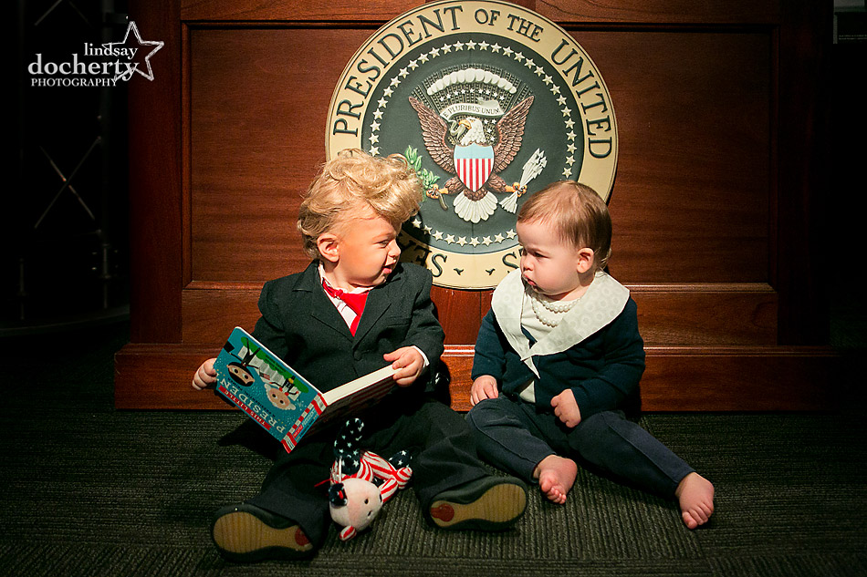 Baby Trump and Baby Clinton reading with presidential seal