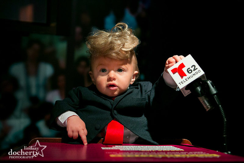 Baby Donald Trump at podium during TV debates