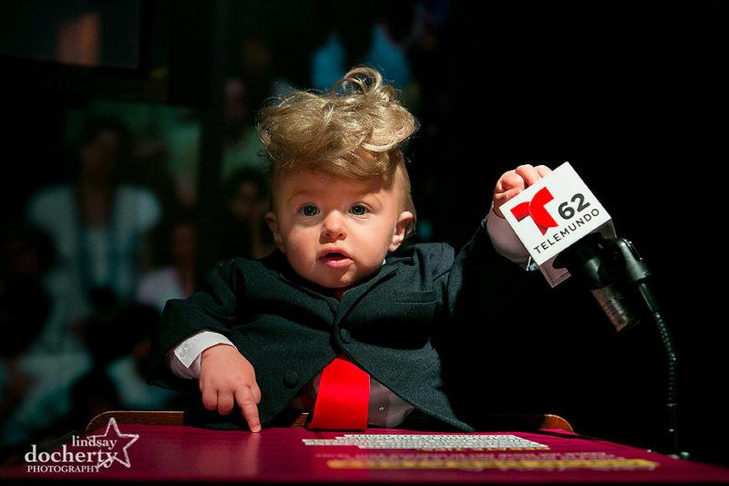 Baby Donald Trump at podium during TV debates