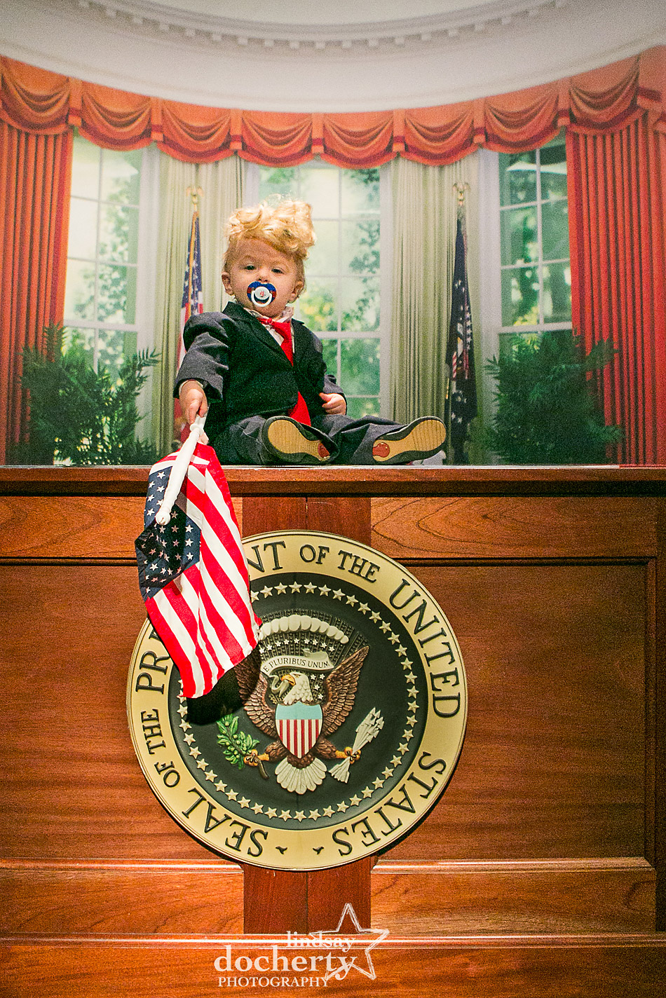 Bably Donald Trump in the Oval Office with flag