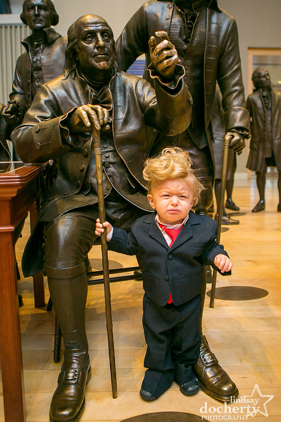 Crying baby Donald Trump with statue of Benjamin Franklin