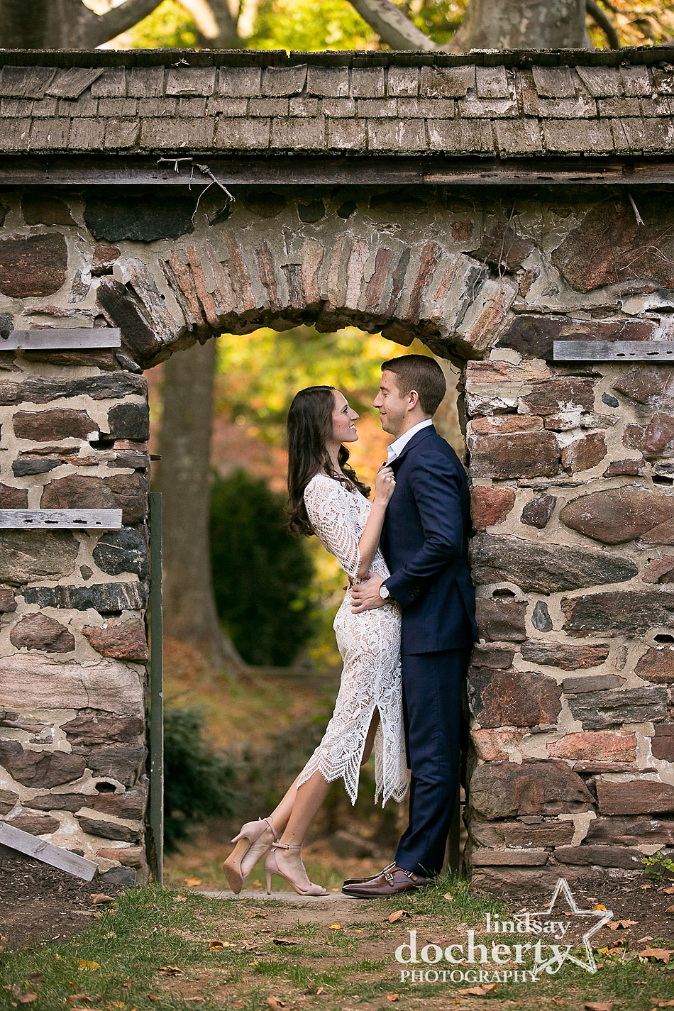 engagement picture in stone doorway at Ridley Creek State Park