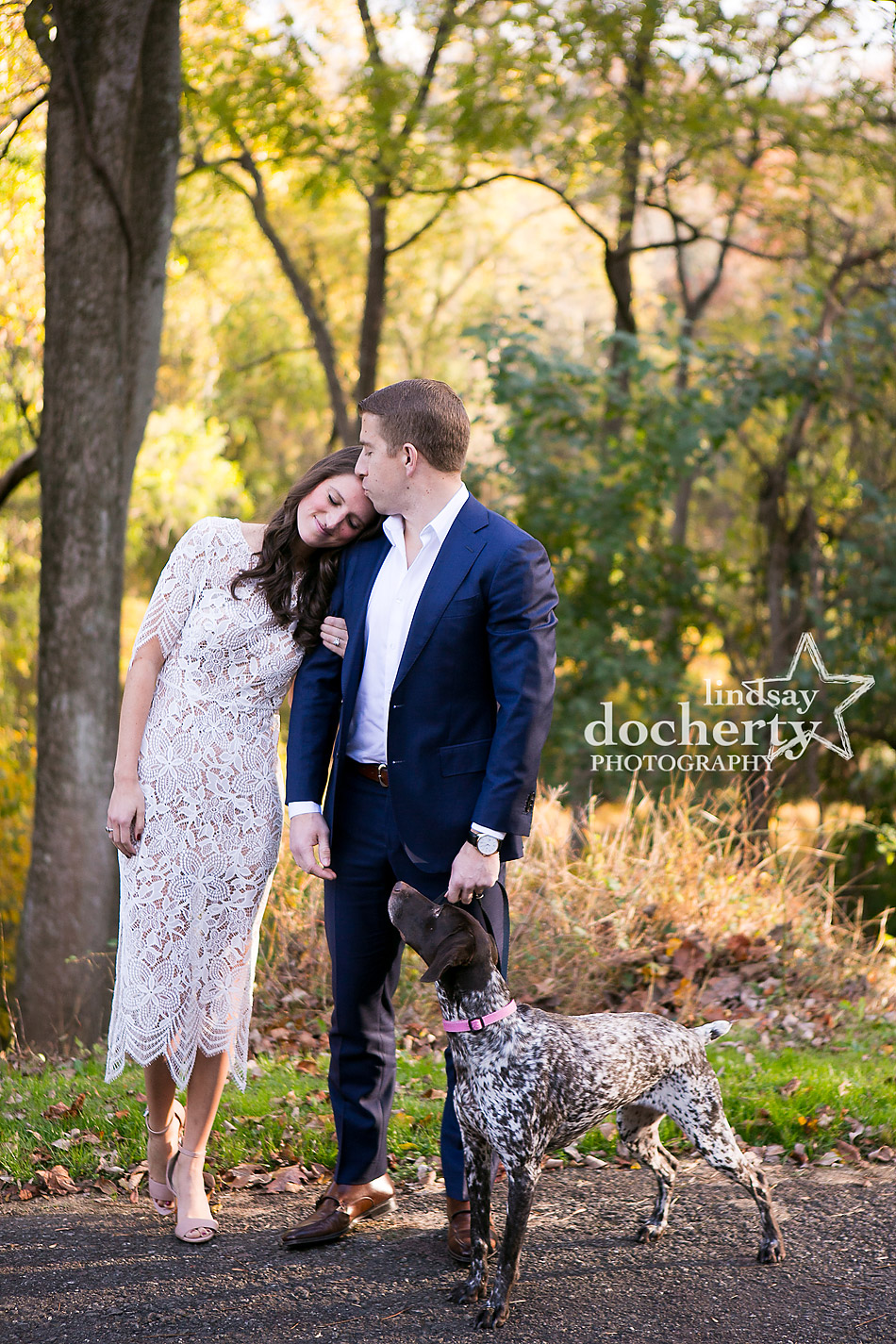fall engagement picture at Ridley Creek State Park with dog