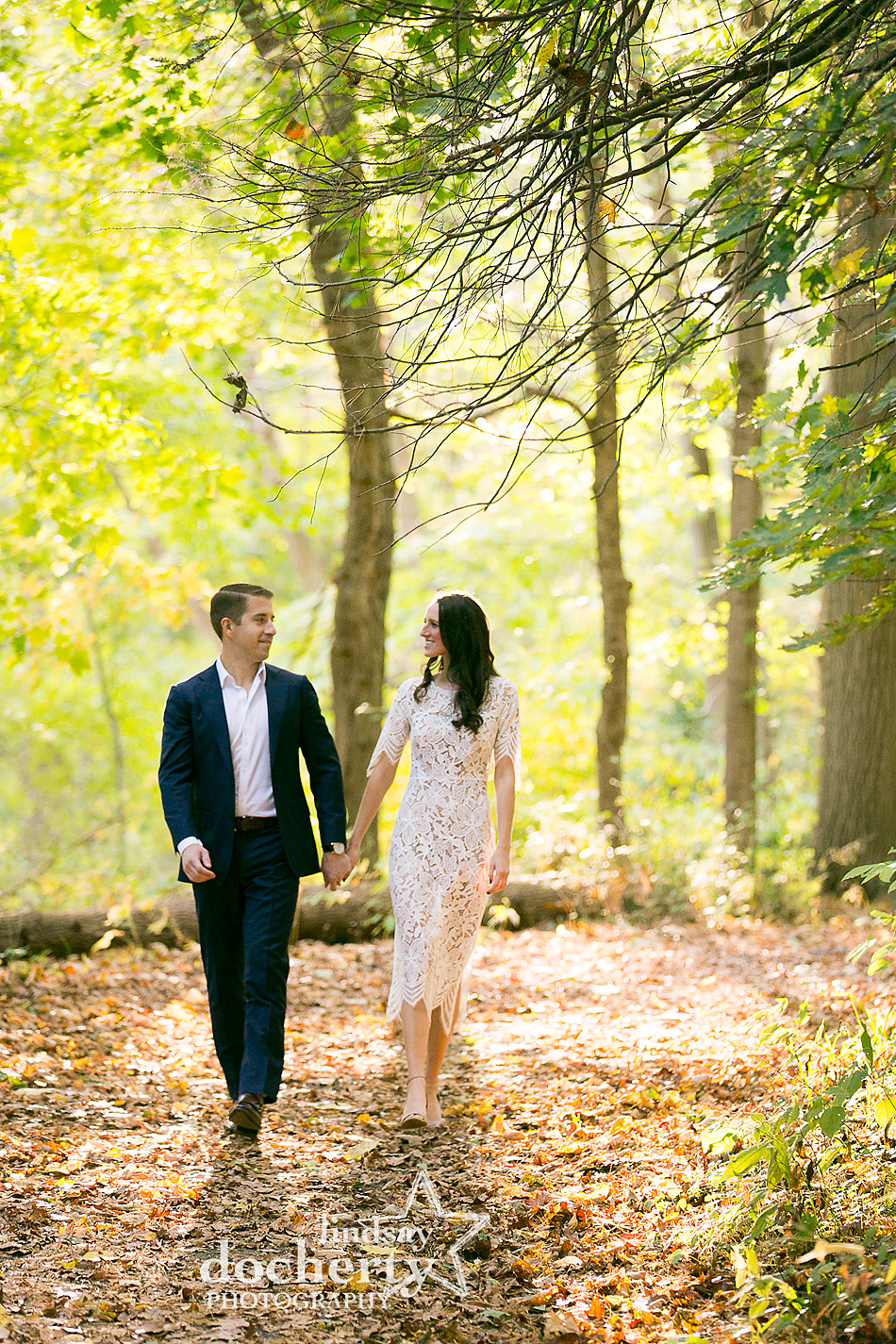 yellow green and orange engagement picture in the woods at at Ridley Creek State Park