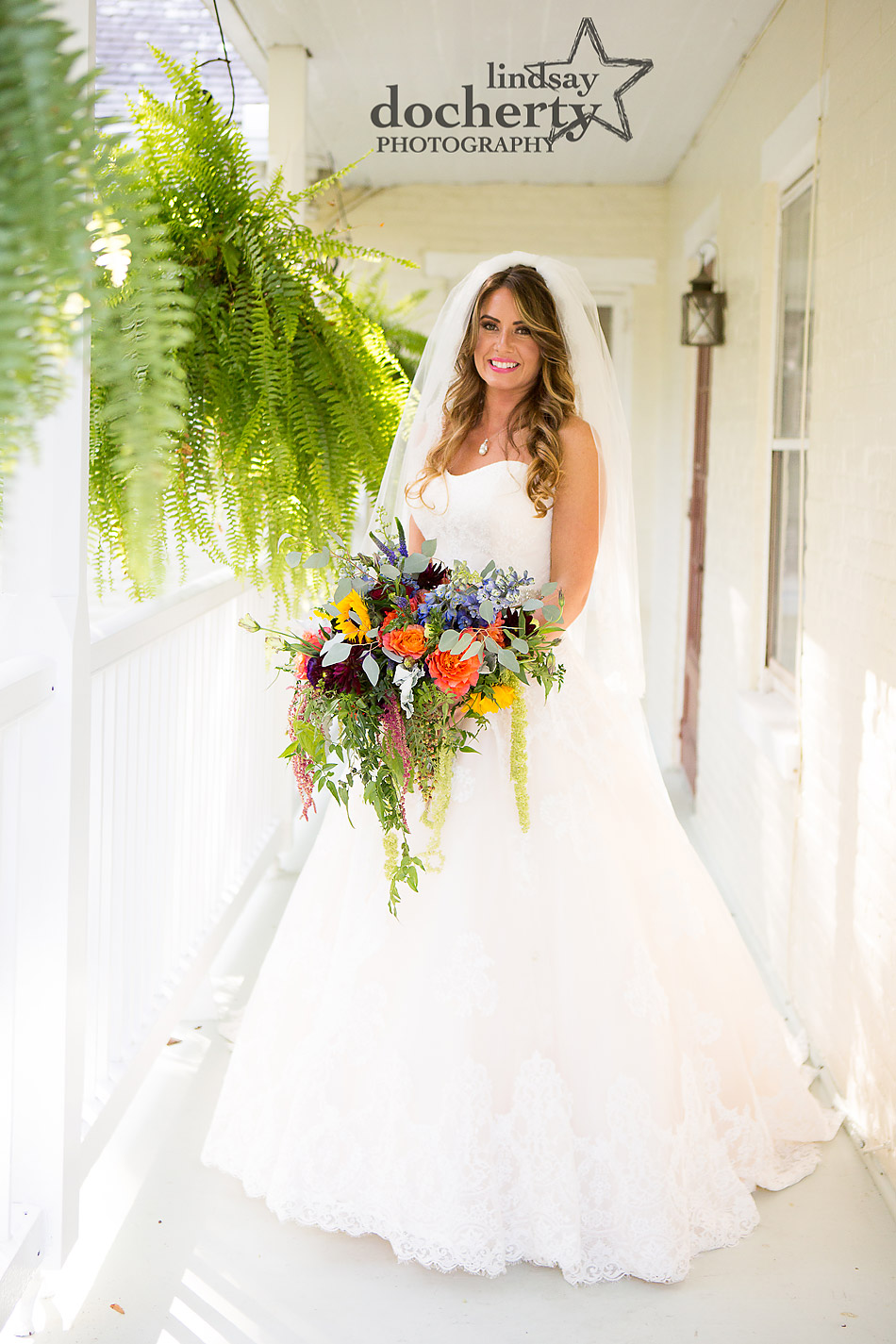 wedding day portrait of bride on balcony at Riverdale Manor