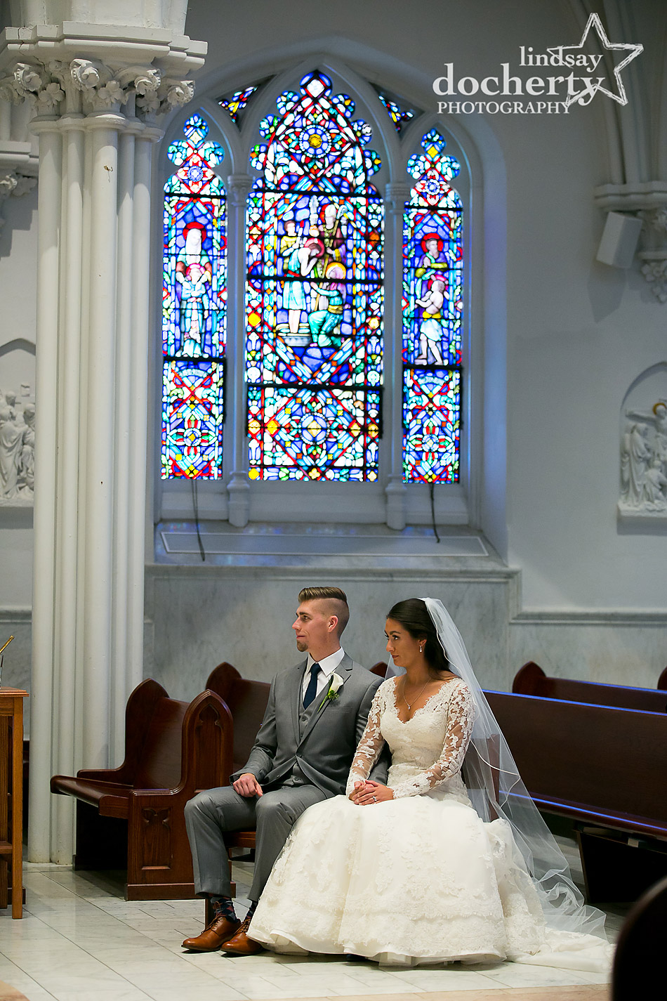 bride and groom at wedding ceremony at St Thomas of Villanova University Church