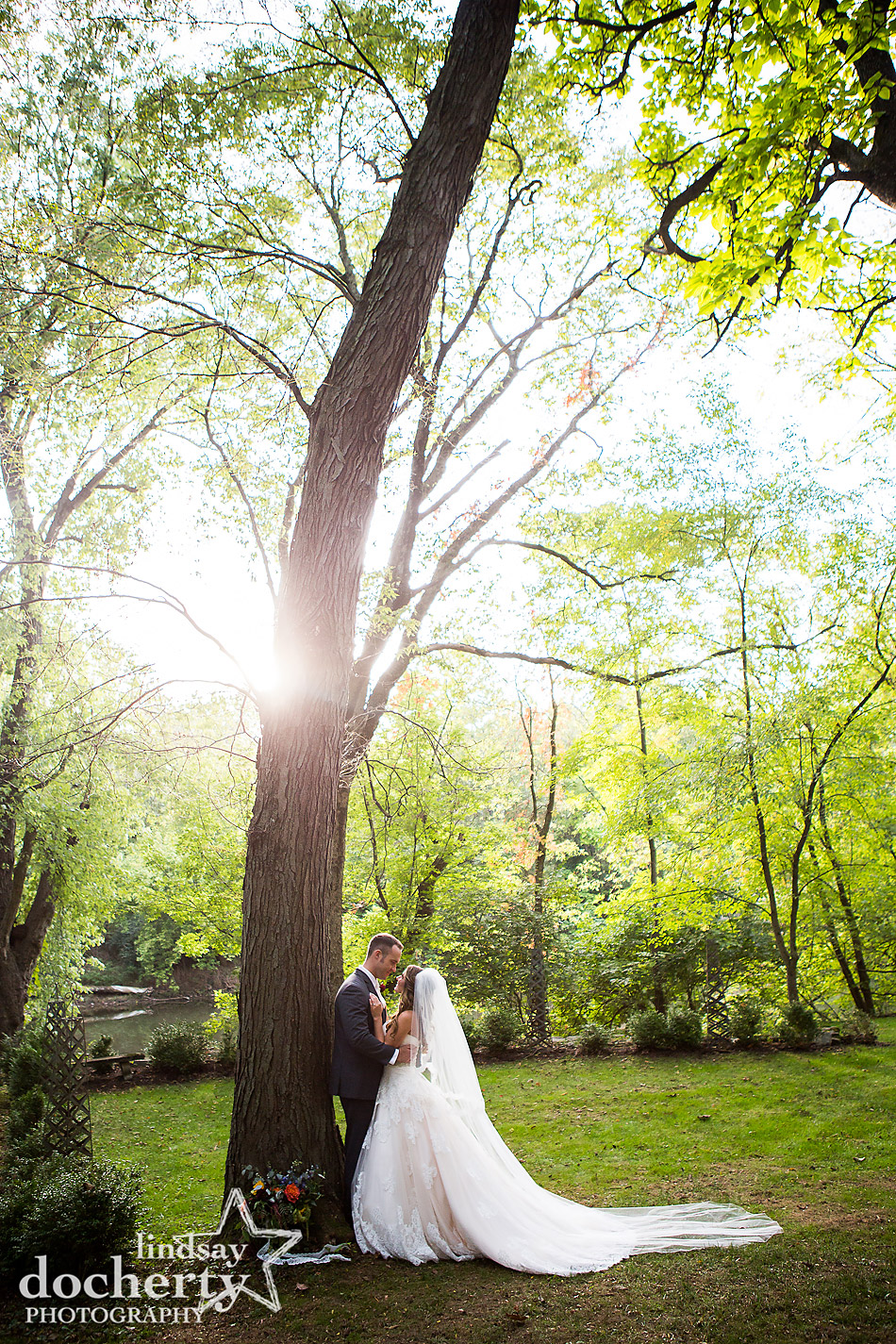 bride and groom backlit wedding picture at Riverdale Manor