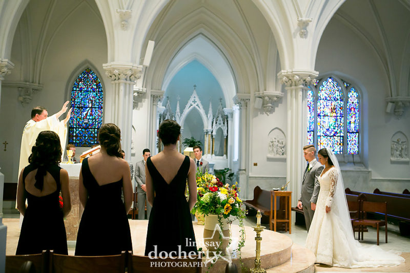 bride and groom during wedding ceremony at Villanova University Cathedral