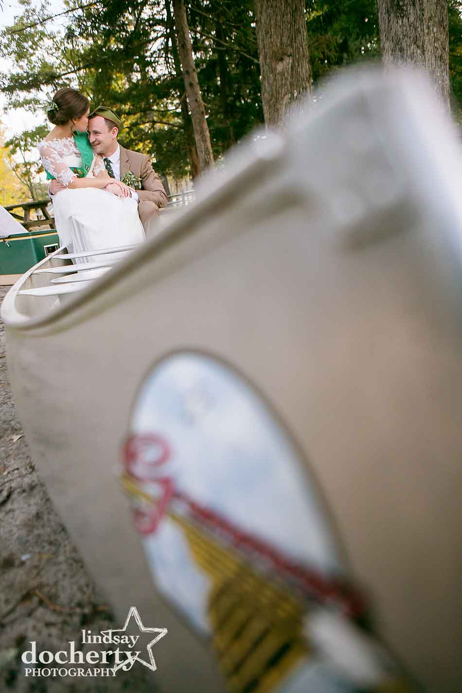 bride-and-groom-in-canoe-at-camp-ockanickon-wedding-in-new-jersey