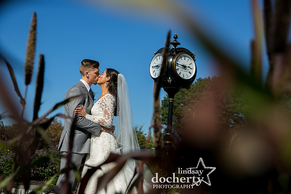 bride and groom kissing outside at clock tower at Llanerch Country Club wedding