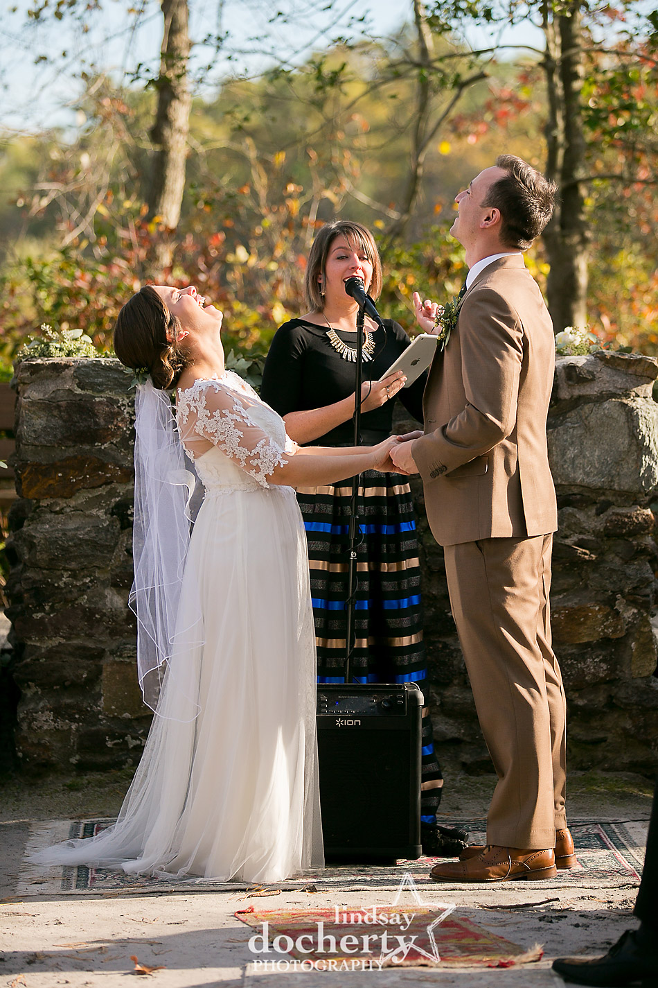 bride-and-groom-laughing-during-ceremony-on-chapel-island-camp-ockanickon-wedding-in-new-jersey