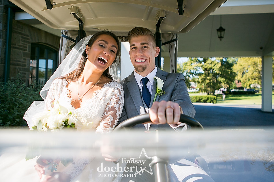 bride and groom on golf cart at Llanerch Country Club
