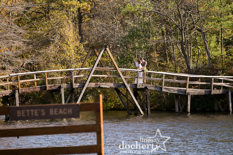 bride-and-groom-portrait-on-bridge-at-camp-ockanickon-wedding-in-new-jersey
