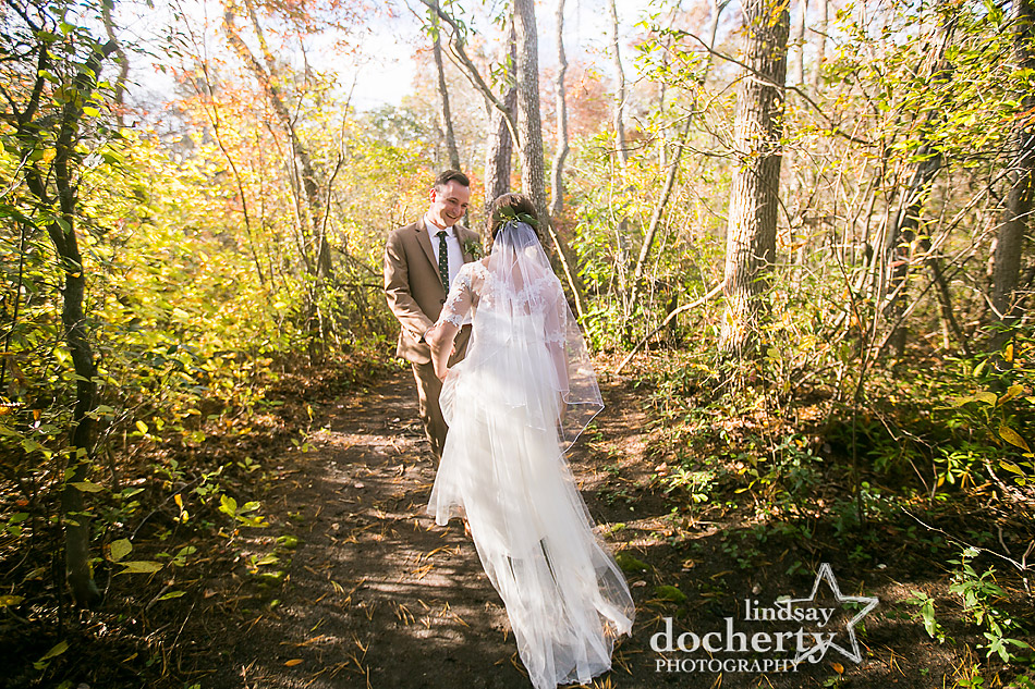 bride-and-groom-smiling-immediately-after-wedding-ceremony-at-camp-ockanickon-in-new-jersey