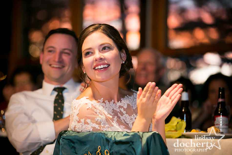 bride-during-toast-at-reception-at-camp-ockanickon-wedding-in-new-jersey