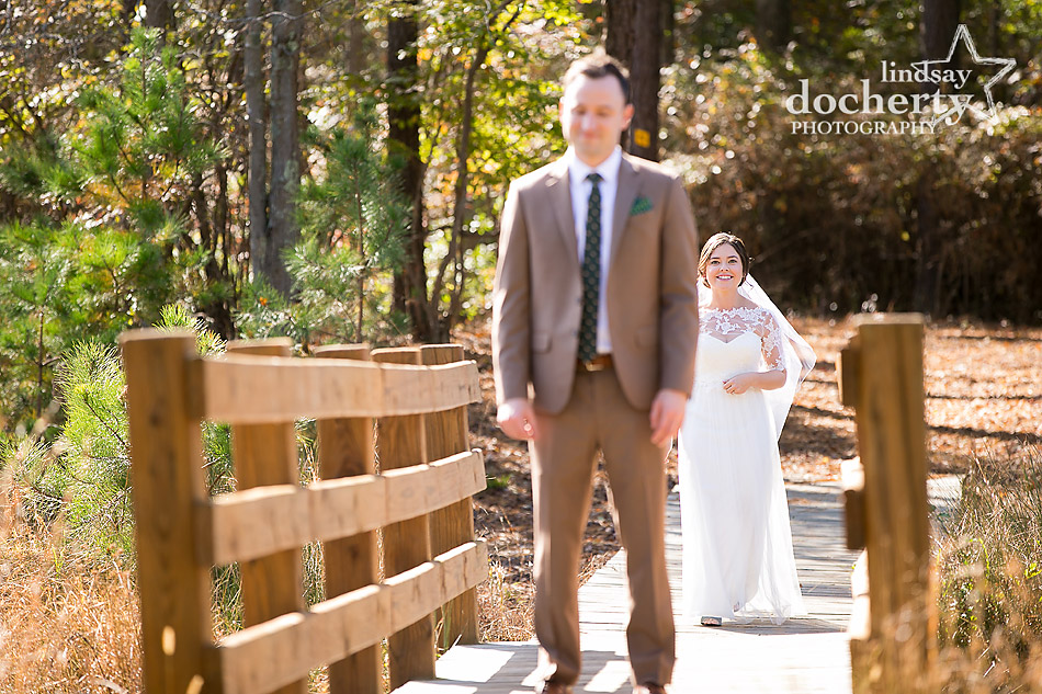 bride-walking-up-to-groom-for-first-look-at-camp-ockanickon-wedding-in-new-jersey