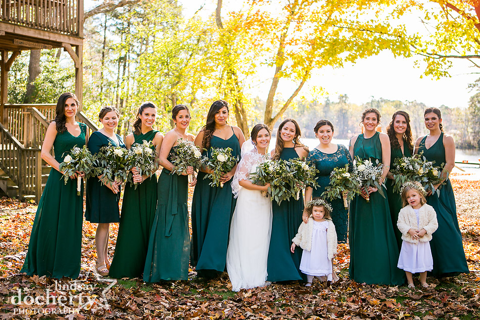 bridesmaids-in-different-emerald-green-dresses-at-camp-ockanickon-wedding-in-new-jersey