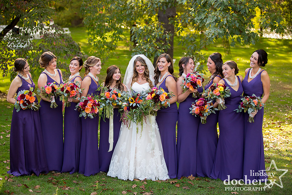 bridesmaids in long eggplant purple dresses at Riverdale Manor
