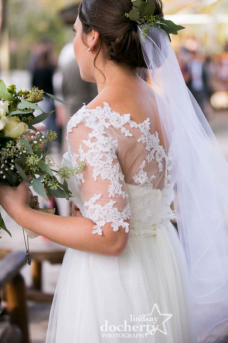 delicate-lace-top-of-brides-dress-with-eucalyptus-flowers-and-veil