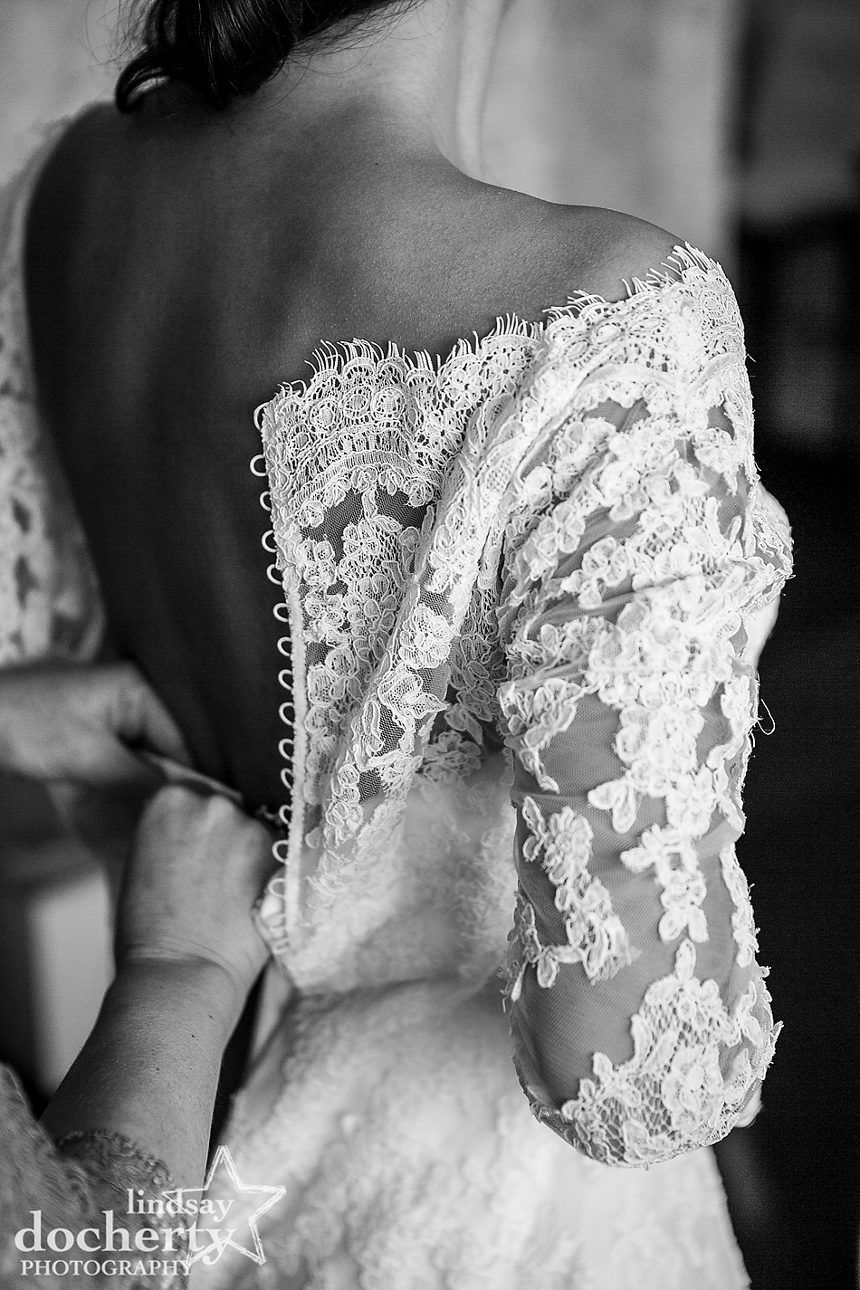 eyelash lace and buttons on wedding dress getting ready