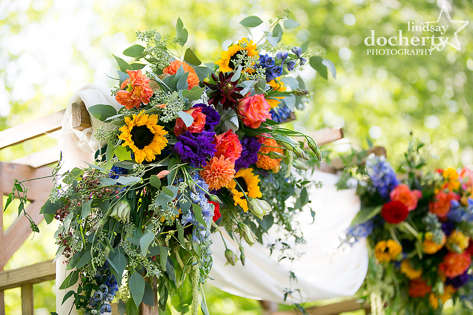 fall flowers on wedding arch at Riverdale Manor